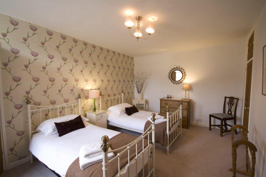 Twin bedroom. Image credit to George Skipper